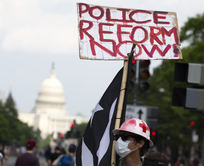 Credit NPR. A demonstrator holds a placard during a march against racism and police brutality in Washington, D.C., on Saturday. Congressional Democrats have released a wide-ranging proposal aimed at overhauling policing Jose Luis Magana/AFP via Getty Images